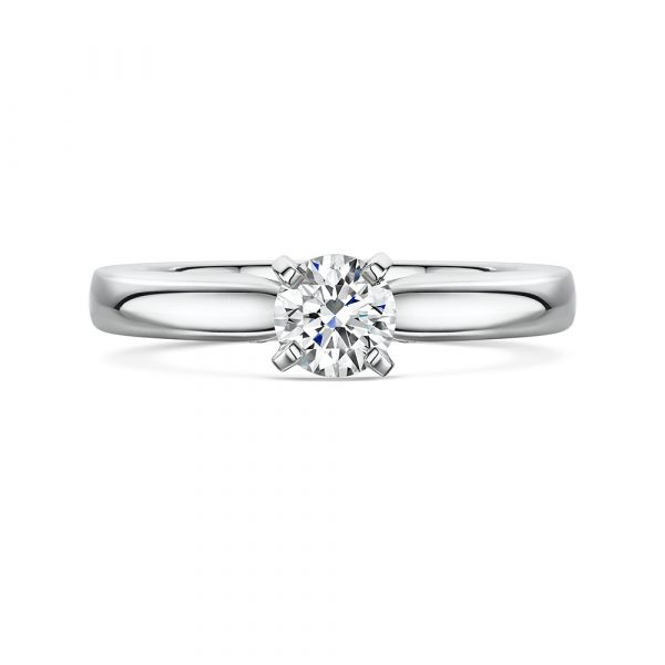 platinum four claw solitaire engagement ring featuring a round brilliant cut diamond